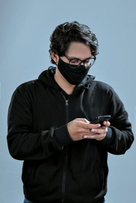 man in black zip up jacket wearing black framed eyeglasses